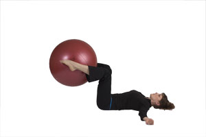 Lying Knee Extensions with Exercise Ball