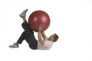 Lying Leg Extension Crunches with Exercise Ball